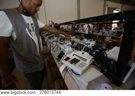 Salvador, Bahia / Brazil - October 17, 2018: Technicians Prepare An Electronic Ballot Box For Electi
