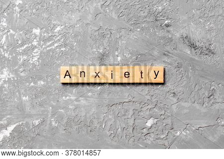 Anxiety Word Written On Wood Block. Anxiety Text On Table, Concept