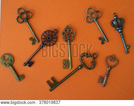 Many Different Old Keys From Different Locks, Scattered Chaotically, Flat Lay. Finding The Right Key