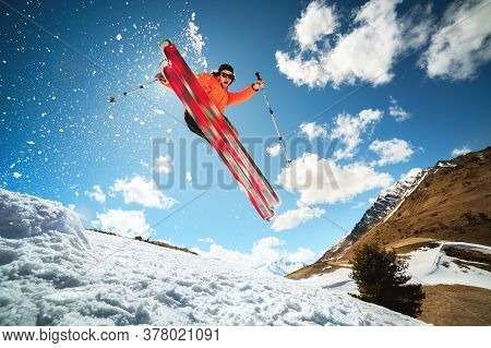 Jump With A Trick In The Ozdou Athlete Skier With A Kicker On A Sunny Day Of Spring Or Winter Agains
