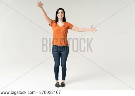 Happy Pretty Young Woman Standing With Arms Outstretched To Give Hug