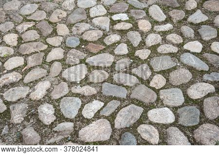 Cobblestone Pavement Of A Walkaway, Vintage Style Paving Of Roads And Paths
