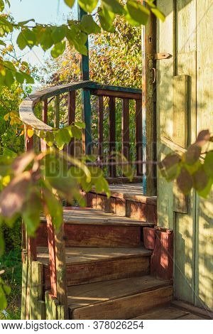 Cozy Wooden Spiral Stairway Of Country House Porch In The Sunny Sunset Light, Countryside Concept, R