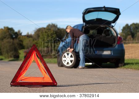 Broken Down Car With Red Warning Triangle