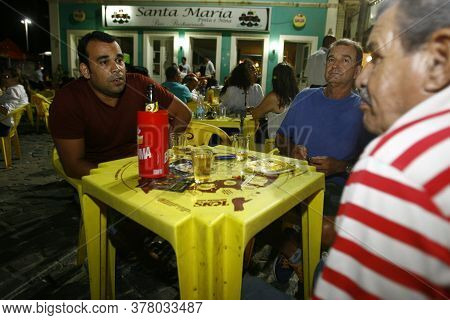 Salvador, Bahia / Brazil - October 9, 2014: Bar Patrons Are Seen Drinking Beer In The Rio Vermelho N