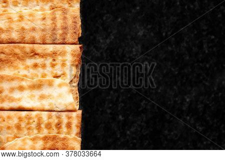 Top View Of A Series Of Crisp Cookies Piled On Black Marble. Freshly Baked Cookies. Selective Soft F