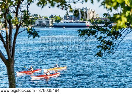 Victoria, British Columbia / Canada - 06/23/2015 Bridges, Water Taxis And Canoeists In Idyllic Victo