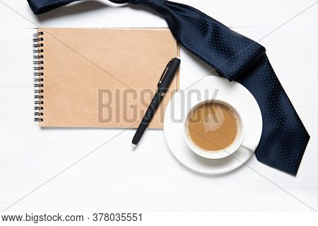A Cup Of Coffee, A Notebook And A Tie On The Table. Daddy's Day Holiday Concept