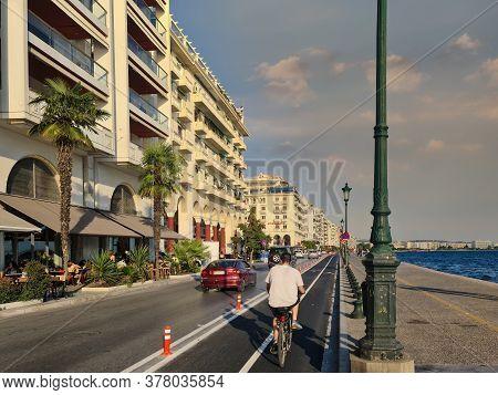 Thessaloniki, Greece - July 24 2020: New Urban Transport Bikeway Next To An Asphalt Road. Traffic On