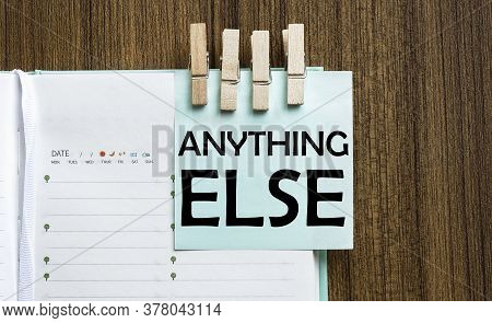 Anything Else Notes Paper And A Clothes Pegs On Wooden Background