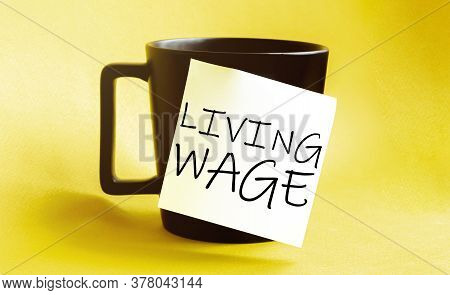 White Paper With Text Living Wage On The Black Cup