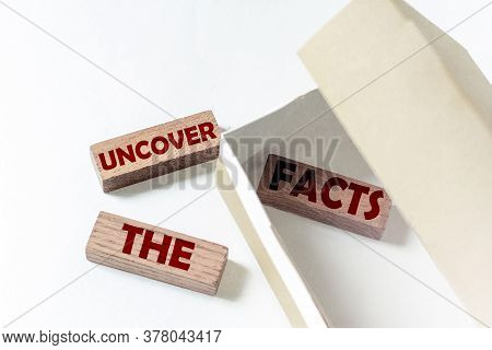 Wooden Blocks With Text Uncover The Facts In A Box On A White Background