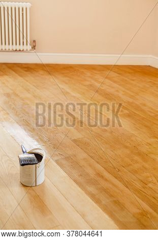 Sanding And Staining A Wooden Floor In A Room, Uk
