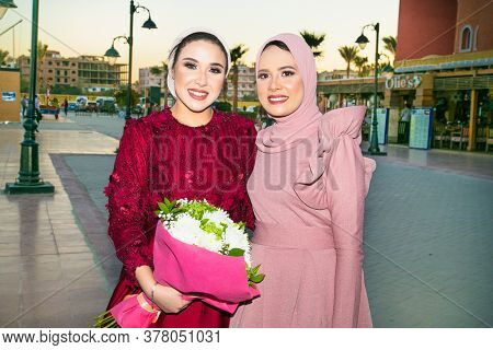 Hurghada, Egypt- Jan 30 , 2020:  Two beautiful Egyptian young women with a bouquet of flowers in Hurghada, Egypt.