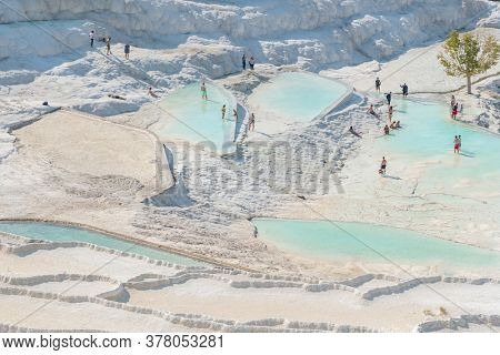 Pamukkale, Turkey - October 17, 2019: Beautiful landscape with Travertines terraces with tranquil water in Pamukkale, Turkey.