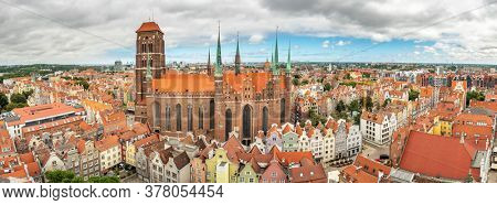 St. Mary's Cathedral in old town of Gdansk, Poland. Panorama cityscape of Gdansk old town at summer