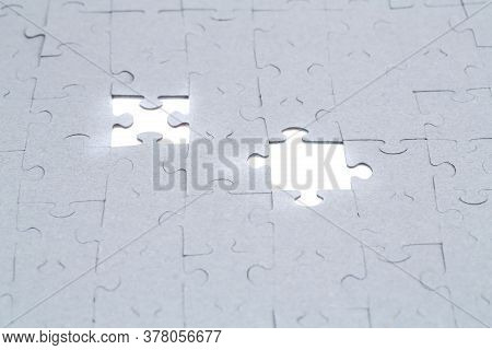 Unfinished Jigsaw Puzzle Pieces On White Background.