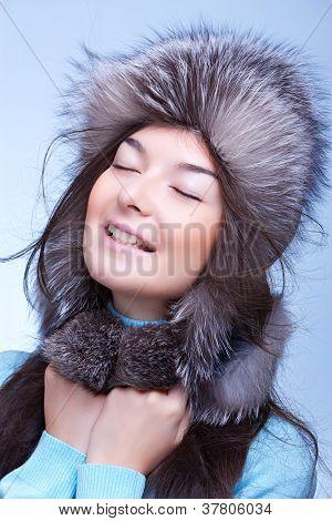 happy woman in fur cap