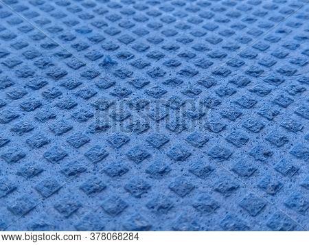 Dishwashing Sponge Background. Close-up Of Blue Dishwashing Sponge. Soft Focus