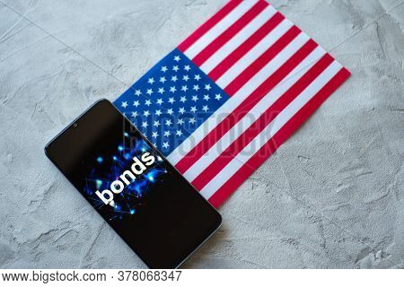 Investment In Bonds In The Usa, Conservative Investment Concept. Smartphone With Inscription On The