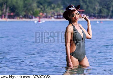 Woman Body Big With Swimsuit Stand At Beach Koh Chang Thailand. Koh Chang Is Located In The Eastern