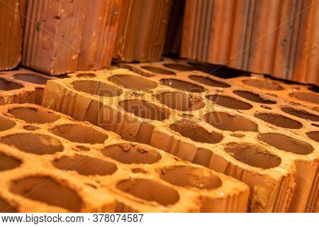 8-hole Orange Fired Ceramic Brick. Material For The Construction Of Houses.