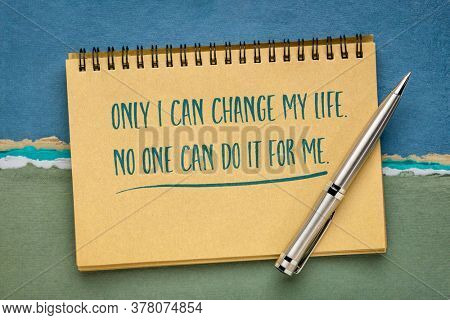 only I can change my life, no one can do it for me inspirational note or posisitive affirmation - handwriting in a spiral sketchbook, personal growth and devleopment concept