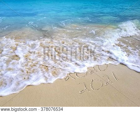 New Year 2021 Tropical Ocean Beach Text With Frothy Surf