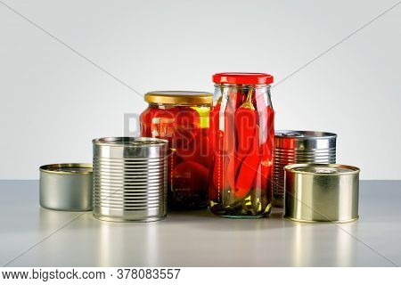 Canning Jars Of Canned, Pickled Vegetable Food On The Table.