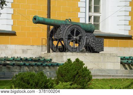 Ancient Cannon Near The Walls Of The Arsenal Building On A Sunny Day. Moscow Kremlin, Russia