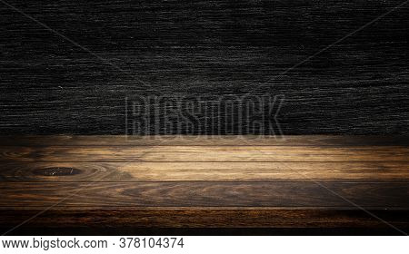 Side View Of Empty Wooden Table Top With Dark Wooden Wall Texture Background For Product Showing.