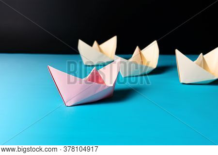 Leadership Concept, Pink Paper Ship Lead Yellow Ship Team Member