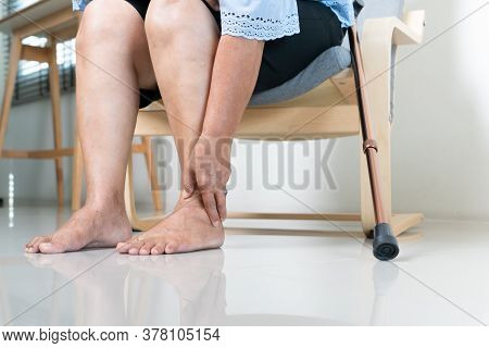 Ankle Leg Pain Of Senior Woman At Home, Healthcare Problem Of Senior Concept