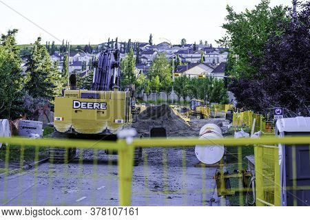 July 25 2020 - Calgary, Alberta Canada - Roadworks Construction Site In Calgary With Equipment, Bull