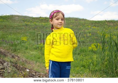 The Child On Background Of The Natur