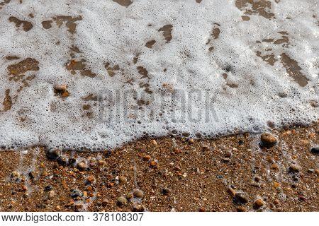 Waves Lapping The Pebbles On Brighton Beach, England, United Kingdom