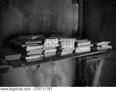 Books Forgotten On A Shelf In A Warehouse