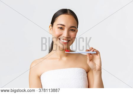 Beauty, Personal Care, And Hygiene Concept. Beautiful Young Asian Woman In Bath Towel Smiling White