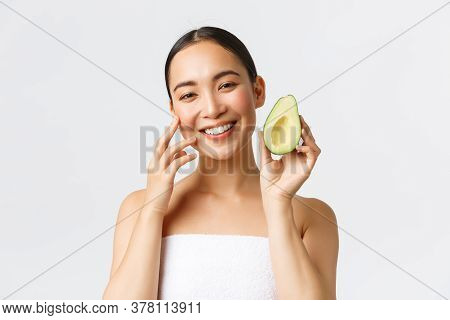 Beauty, Personal Care, Spa And Skincare Concept. Close-up Of Beautiful Asian Woman In Bath Towel Gen