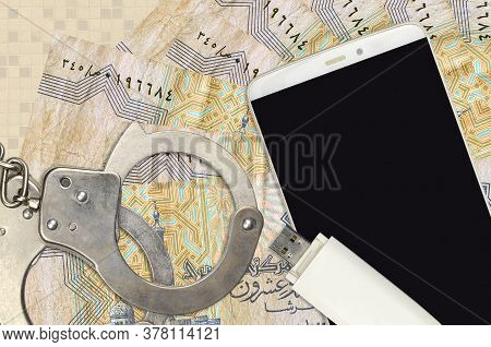 25 Egyptian Piastres Bills And Smartphone With Police Handcuffs. Concept Of Hackers Phishing Attacks