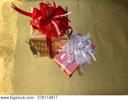 Photo Close-up Christmas Boxes With Presents On A Gold Background