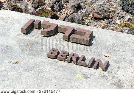 Belzec, Poland - June 12, 2020: Berlin City Name In Yiddish And Polish Language At Belzec Exterminat