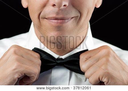 Man In Tux Straightens Bowtie, Two Hands