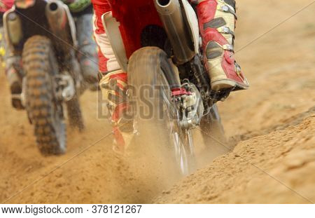 Motocross Racer Accelerating Increases Speed In Track