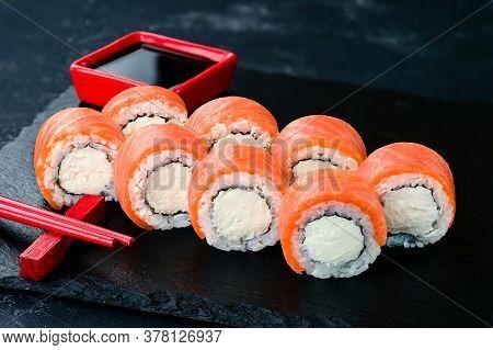 Beautiful Classic Sushi Set Rolls Philadelphia Close Up With Salmon And Cream Cheese Close Up. Urama