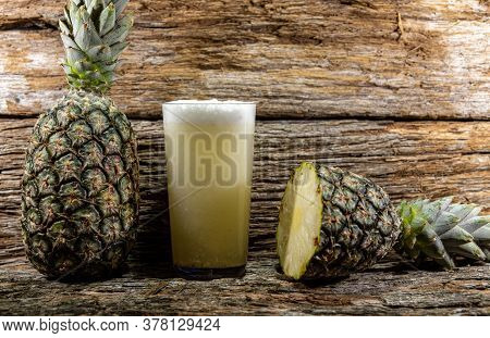 Fresh Fruits And A Glass Of Pineapple Juice