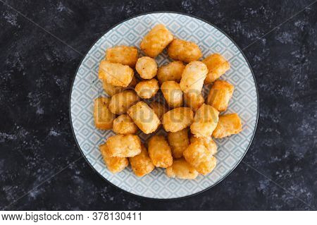 Simple Food Ingredients Concept, Air Fryed Potato Royals On Small Snack Plate On Dark Background