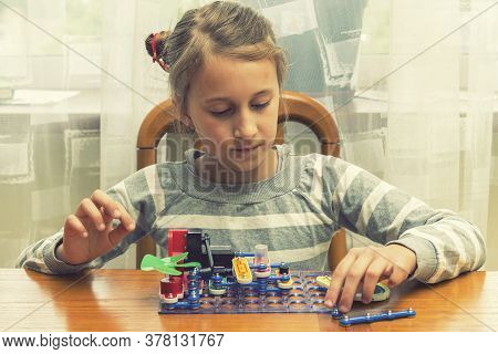 Positive Lady Playing With Toy. She Making It From Constructor. Entertainment Concept. Education, Ch