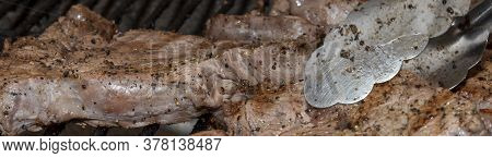 Beef Steak Being Cooked On A South African Braai Or Barbeque