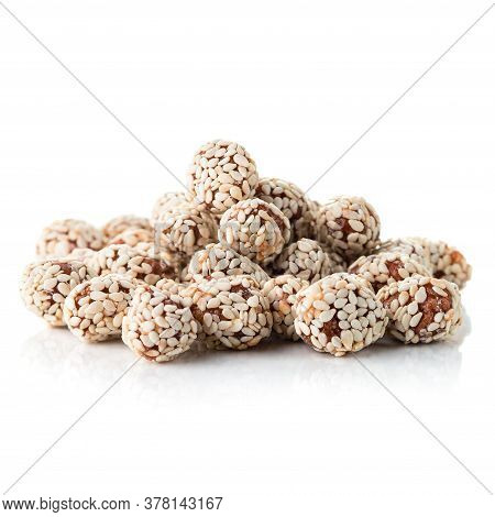 Heap Candy Peanuts With Sesame Seeds, Nuts Glazed In Sesame Isolated On A White Background